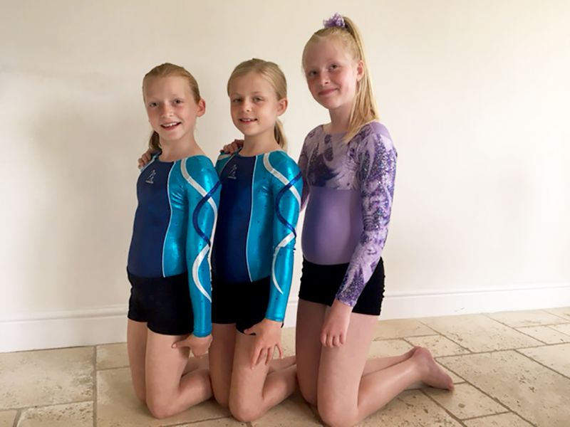 Katie Havill, right, with twins Jess and Sophie
