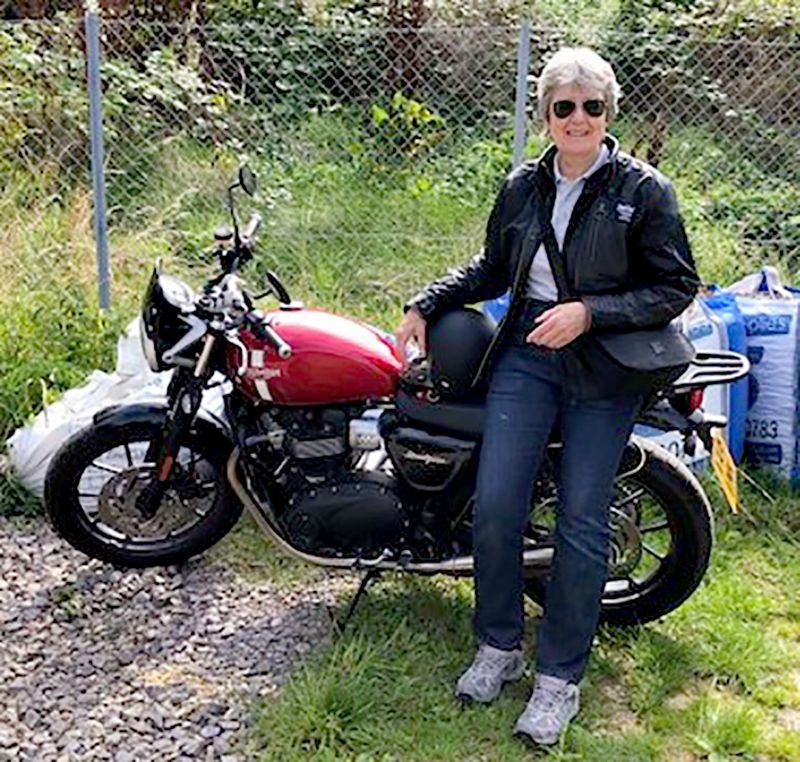 Gloucestershire Netball official Lesley Thomas with her 900cc motorbike