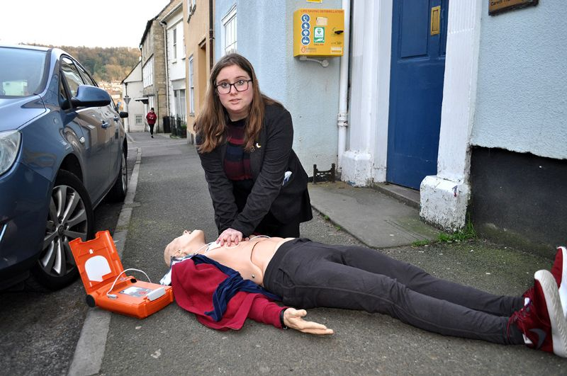 Year 13 student and a founding member of the British Heart Foundation's new group at KLB school Becca Marsh demonstrating the use of a defib on a resuscitation mannequin.