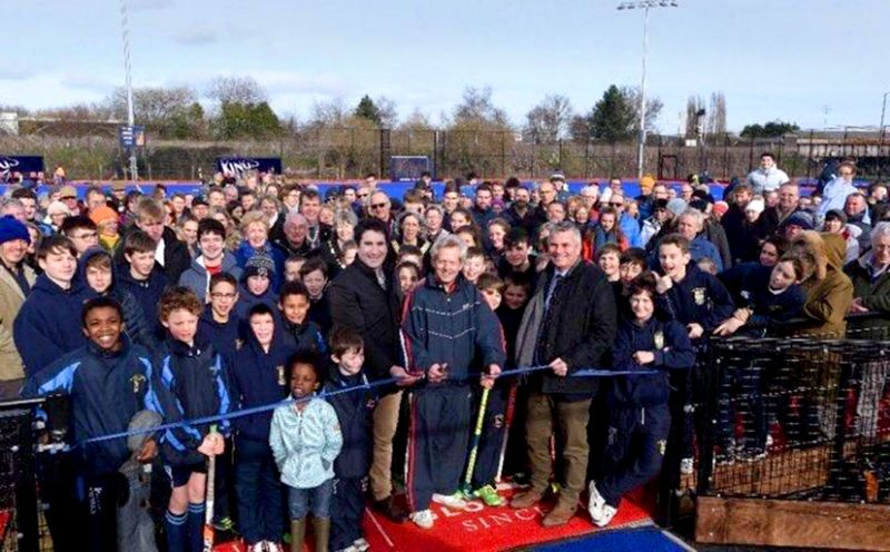 Richard Graham opening the new AstroTurf at Archdeacon Meadow with the Head & Chair of Governors of King's School