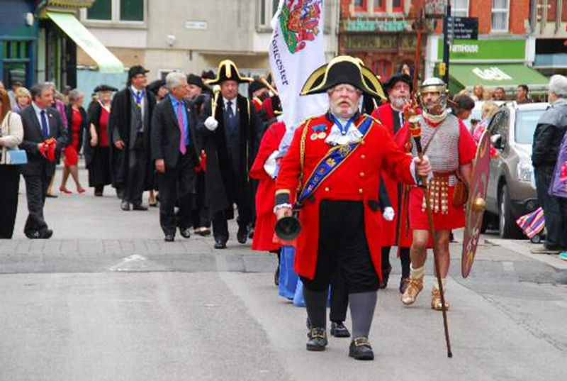 Alan Myatt leads the Gloucester Day parade