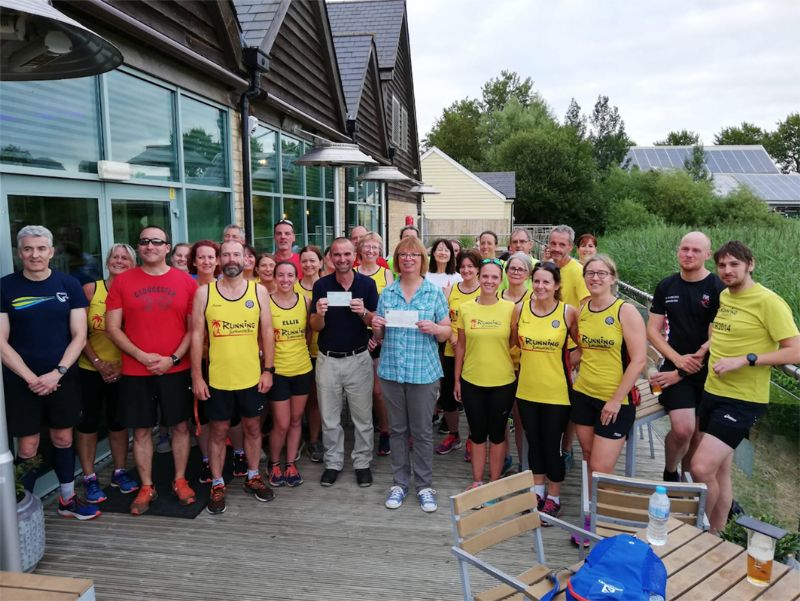 Running Somewhere Else have presented  a cheque for £2,540 to local charity Cirencester Signpost