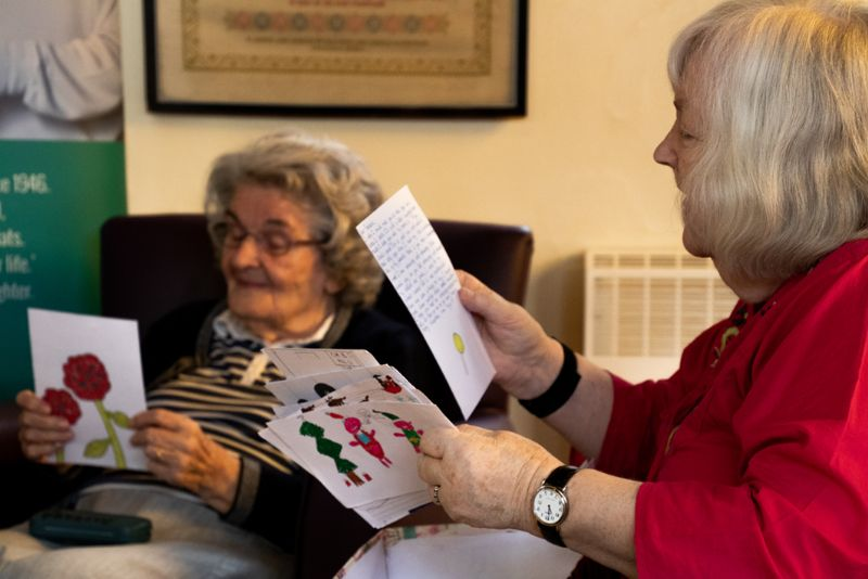 Some of Lilian Faithfull's residents reading the cards sent to them
