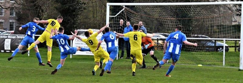 Action from Frampton United (in blue) against Wick. Picture, Pete Langley