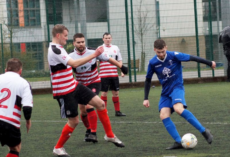 Action from St Paul's United against Kings